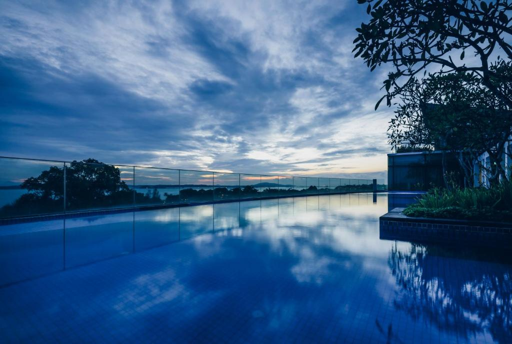 The swimming pool at or near Village Hotel Changi by Far East Hospitality (SG Clean)