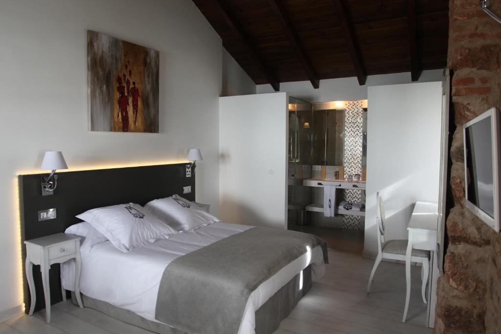 Cama o camas de una habitación en La Casa del Médico