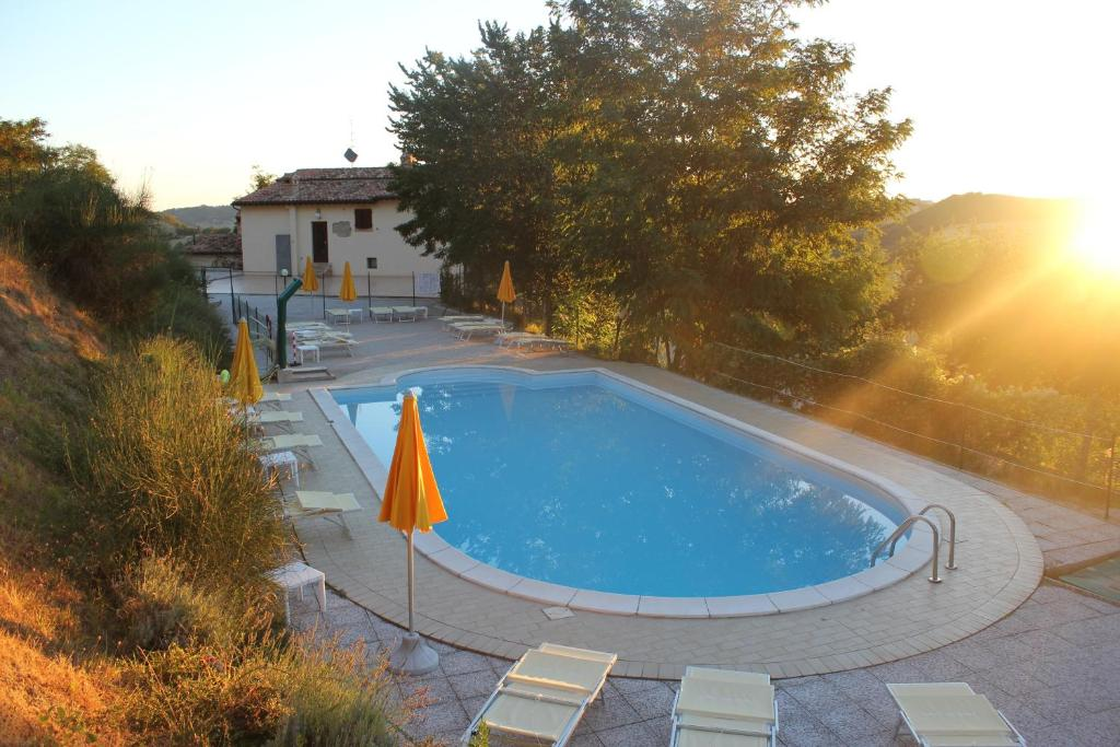 The swimming pool at or near Country House La Valle Del Vento