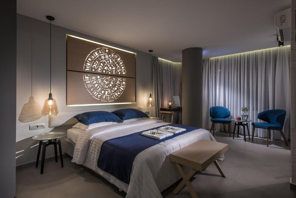 A bed or beds in a room at Lavris City Suites