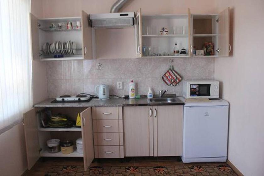 A kitchen or kitchenette at «Домашний уют»