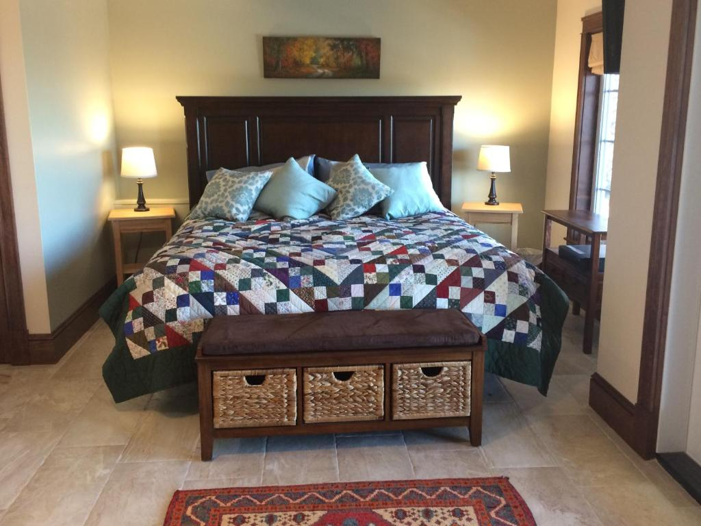 A bed or beds in a room at The Artisan Suites - The Woodland Suite