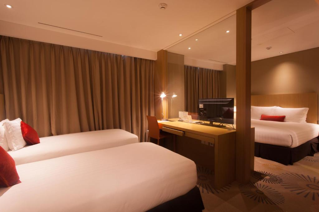 A bed or beds in a room at Solaria Nishitetsu Hotel Busan
