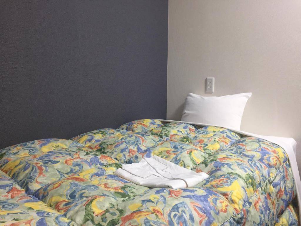 ホテル トーダイにあるベッド
