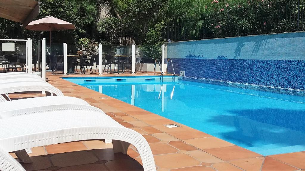 The swimming pool at or near Amarante Cannes