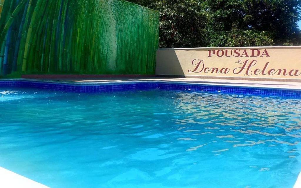 The swimming pool at or near Pousada Dona Helena