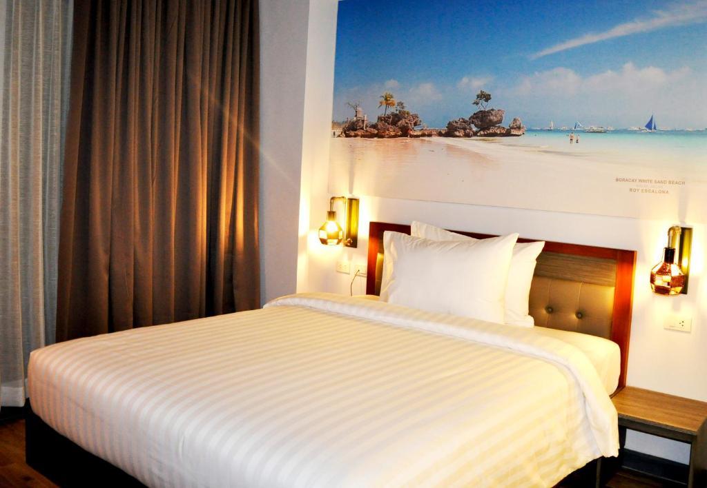 Cama o camas de una habitación en GQ Plaza