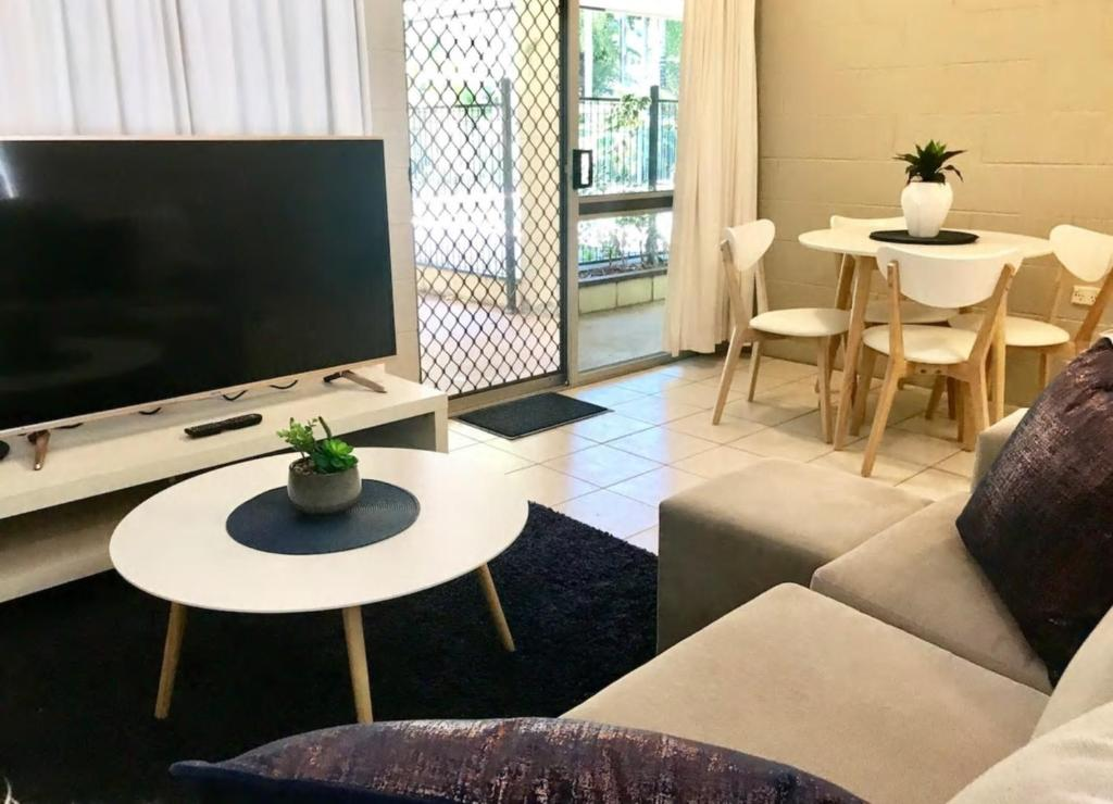 A television and/or entertainment center at TROPICAL living in LEAFY Edge Hill, FREE AC + WIFI