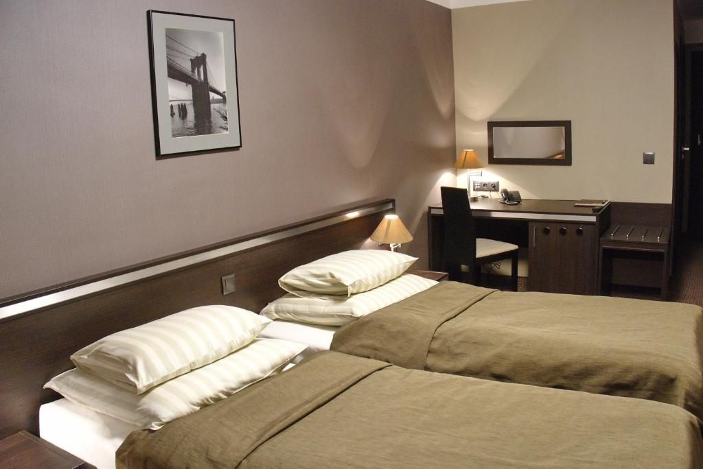 A bed or beds in a room at Hotel Ikar