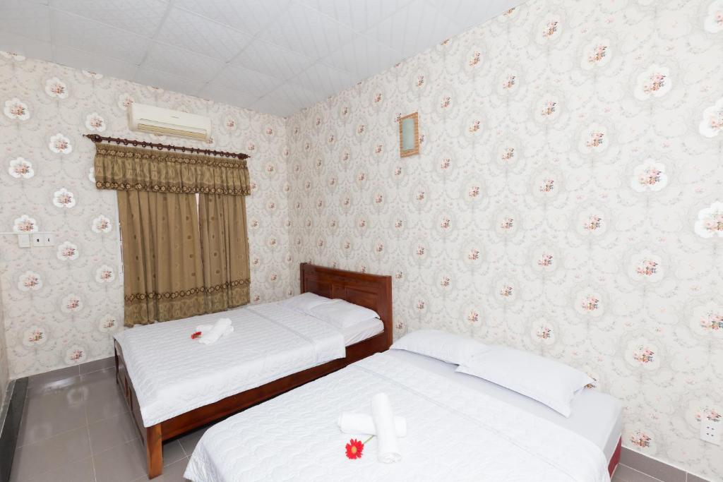 A bed or beds in a room at Thanh Thao