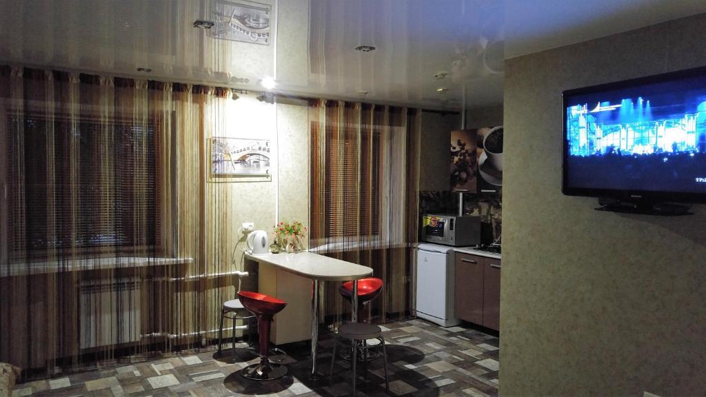 Телевизор и/или развлекательный центр в Apartment on Prospekt Geroev Stalingrada