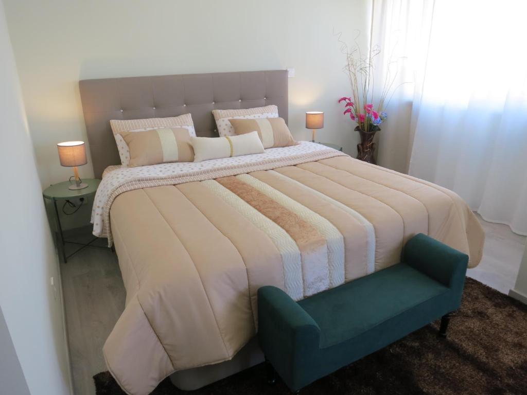 A bed or beds in a room at Hipótese Magnífica