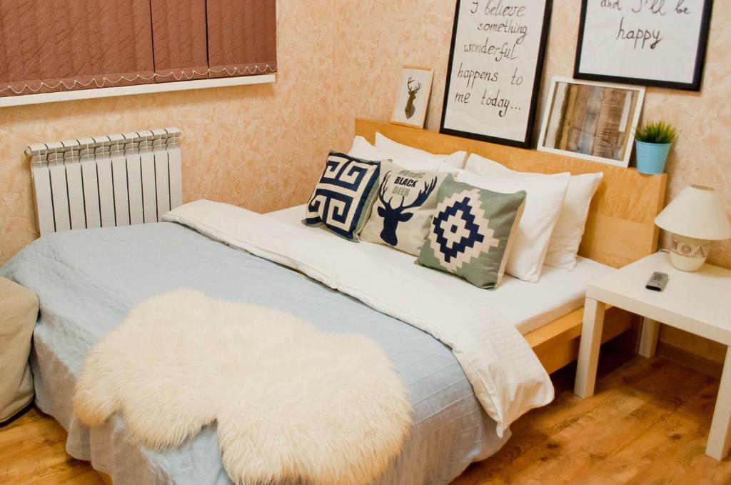 Кровать или кровати в номере ApartHome