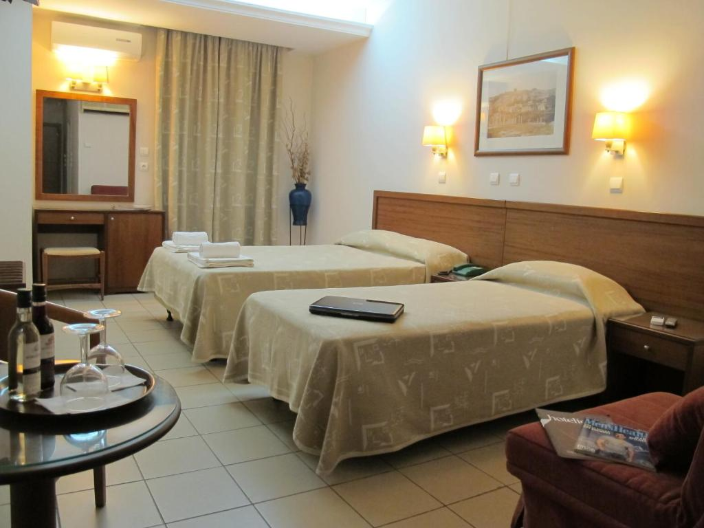 A bed or beds in a room at Hotel Solomou
