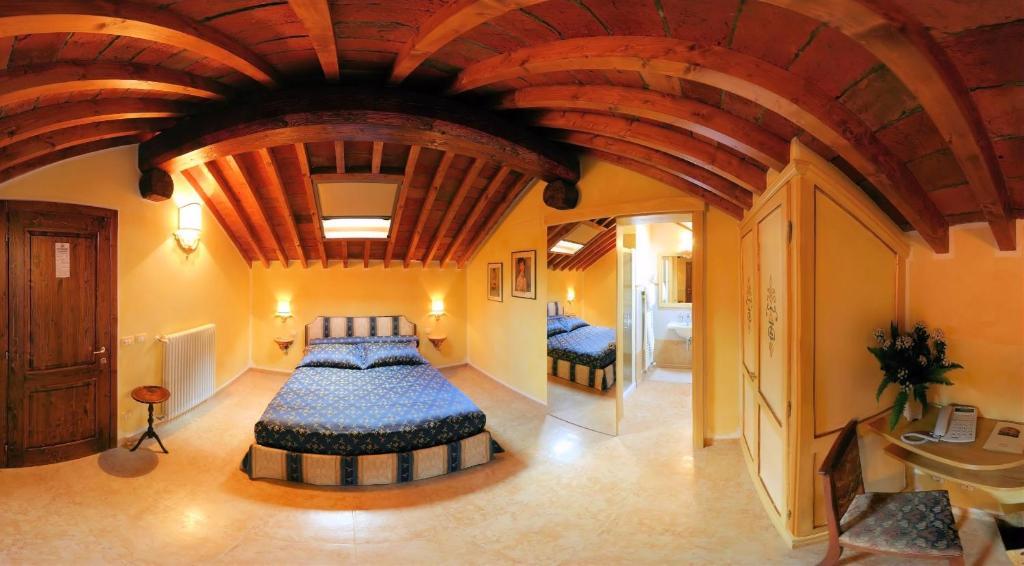Letto o letti in una camera di Locanda Modigliani