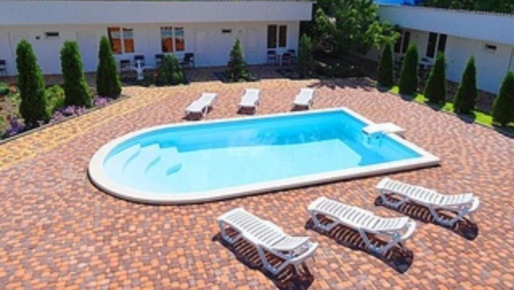 Вид на бассейн в Guest House Belaya Lebed или окрестностях