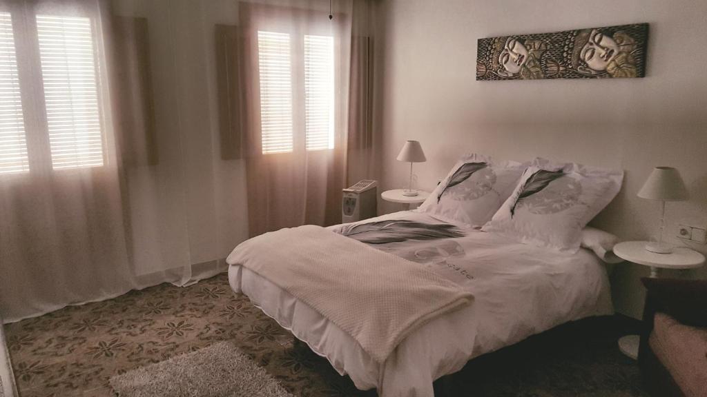 Un ou plusieurs lits dans un hébergement de l'établissement Casa en la Plaza de Zahara