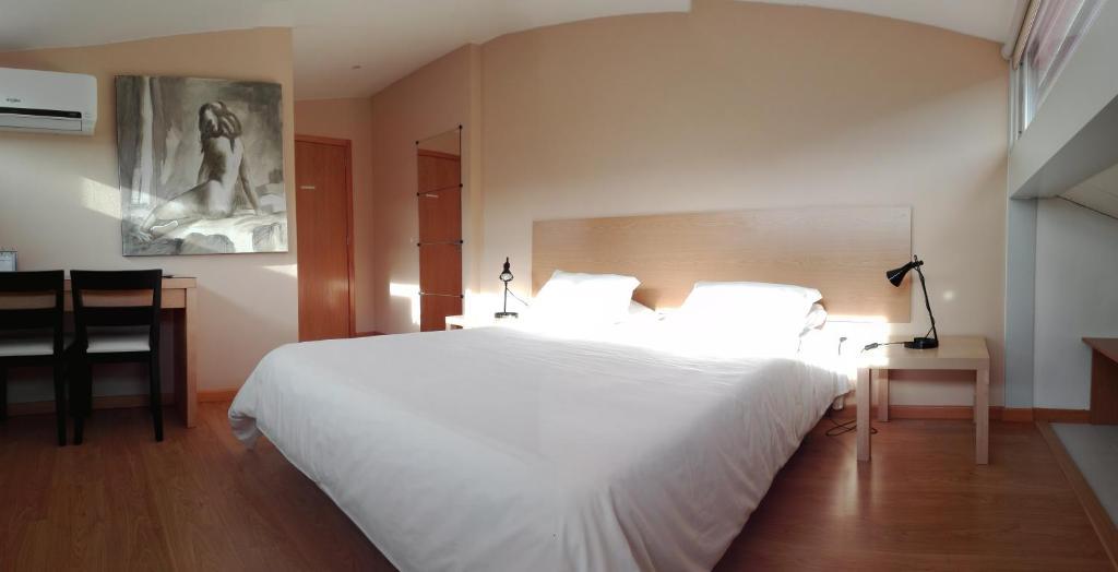 Uma cama ou camas num quarto em Penthouse - Low Cost