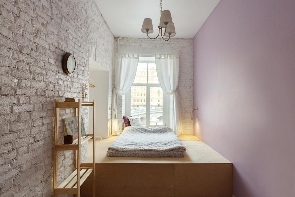 Кровать или кровати в номере Forever Young Hostel