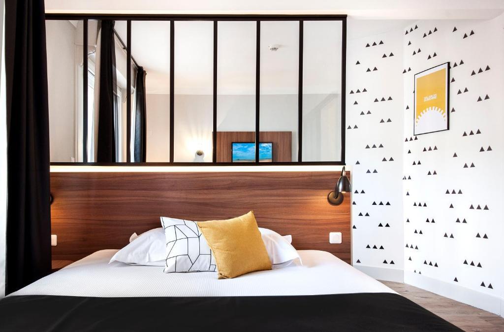 Un ou plusieurs lits dans un hébergement de l'établissement Hôtel Métropole centre ville