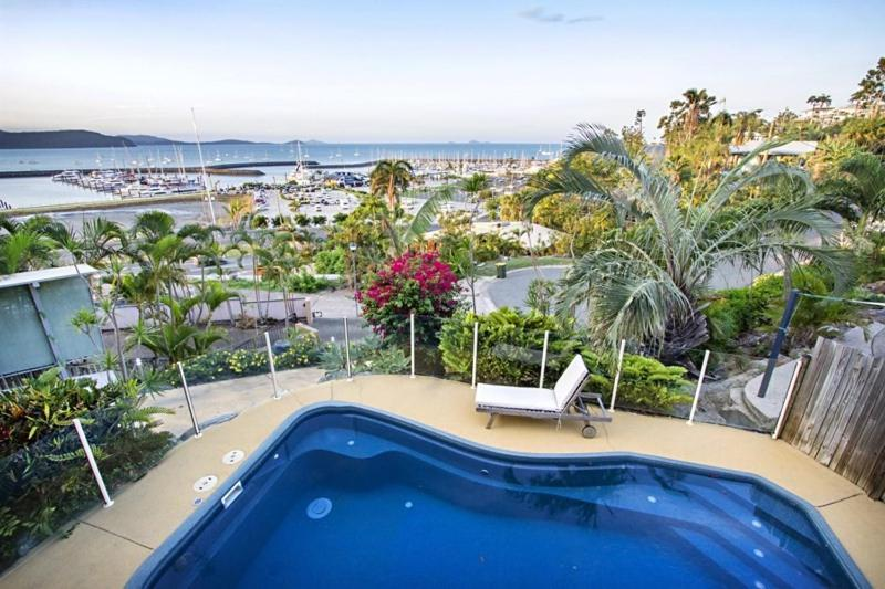 A view of the pool at Amazing Marina views for family or nearby