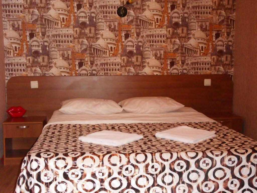 Кровать или кровати в номере Отель на Зеленой
