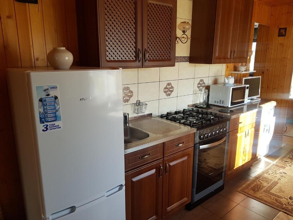 Кухня или мини-кухня в Апартаменты на Подгорной 49
