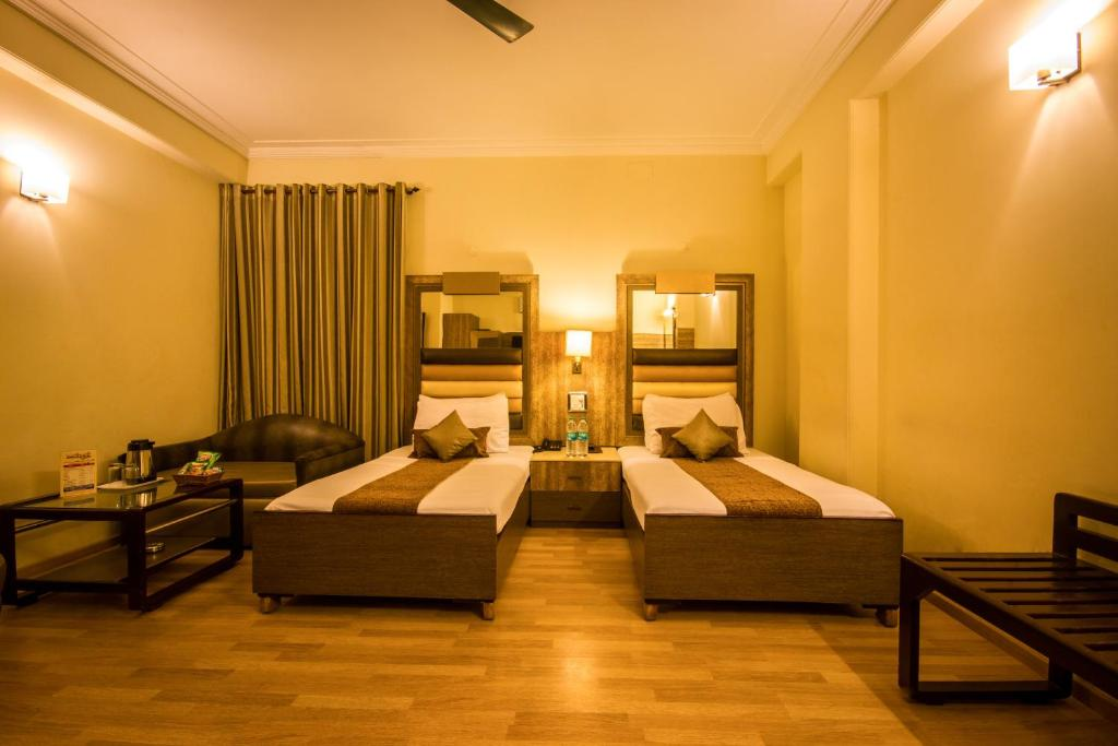 A bed or beds in a room at The Suncourt Hotel Yatri