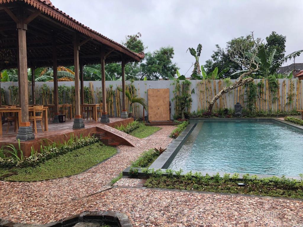 The swimming pool at or near Rumah Dharma 3 Grha Timoho