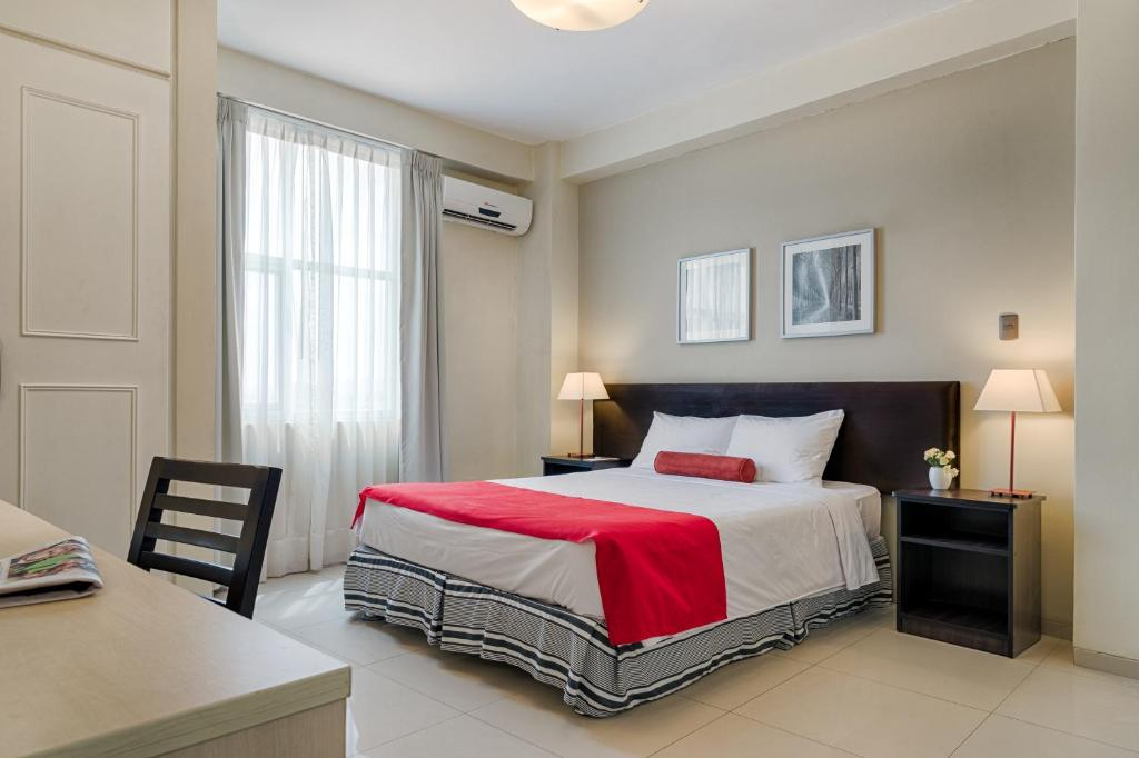 A bed or beds in a room at Mood Hotel Lifestyle