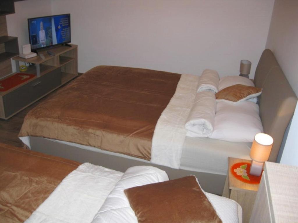 Krevet ili kreveti u jedinici u okviru objekta Apartman Kej Zemun