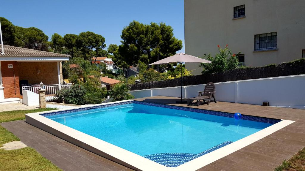 The swimming pool at or near Bungalow with heated private pool