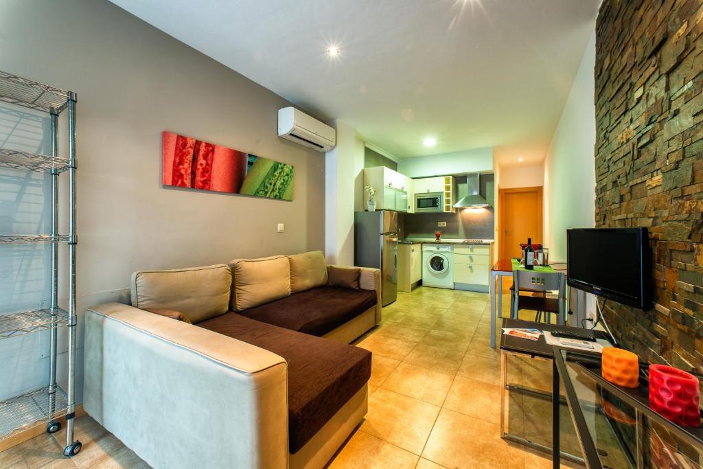 A seating area at Apartamentos Amanecer Murcia