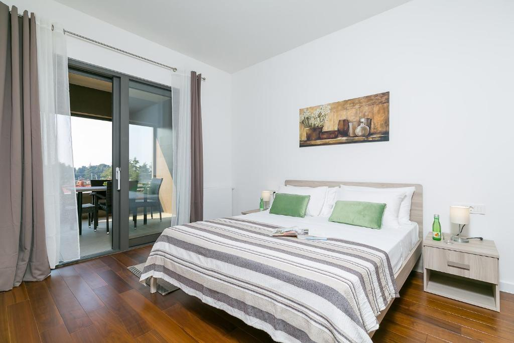 A bed or beds in a room at Spada Residence I