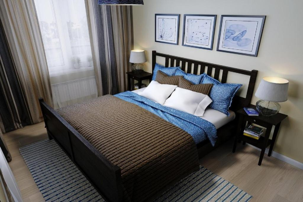 A bed or beds in a room at Guest house at 9 Proseka