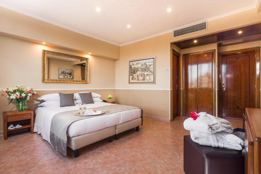 A bed or beds in a room at Raeli Hotel Lux