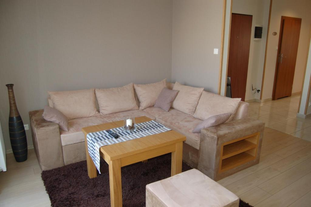 A seating area at Apartamenty Plaza Słupca