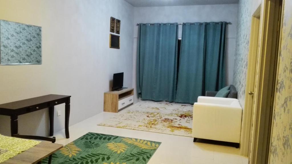 Televisyen dan/atau pusat hiburan di Aliya Muslims Homestay CH