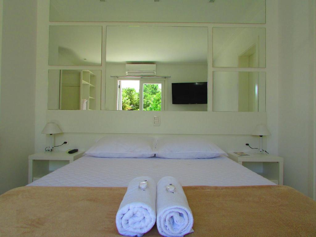 A bed or beds in a room at San Clemente Residence
