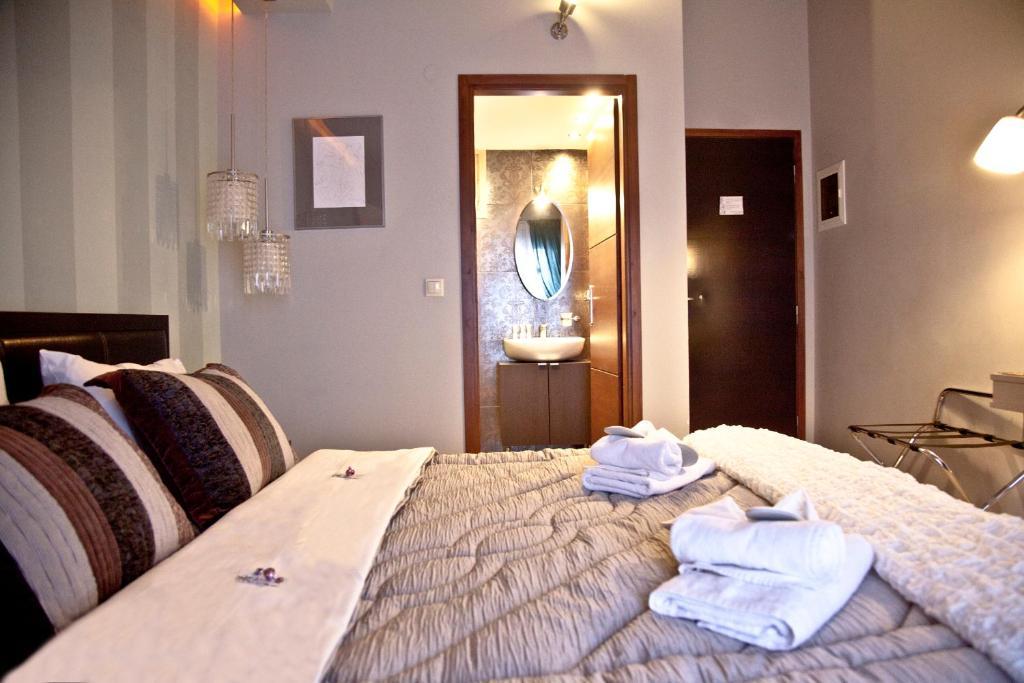 Ένα ή περισσότερα κρεβάτια σε δωμάτιο στο Grimani Pension