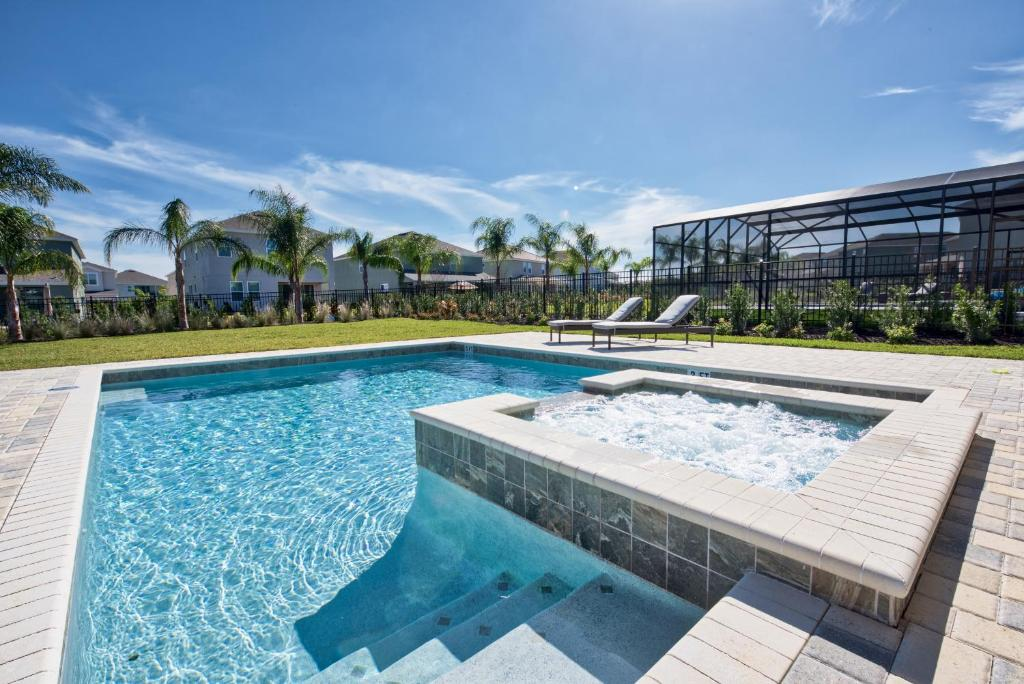 The swimming pool at or close to Outstanding Home with Water Park Access near Disney - 7731F