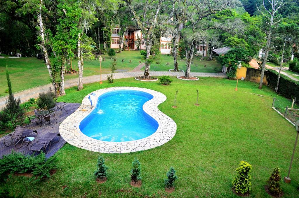 Uma vista da piscina em Pousada Toca Da Coruja ou nos arredores