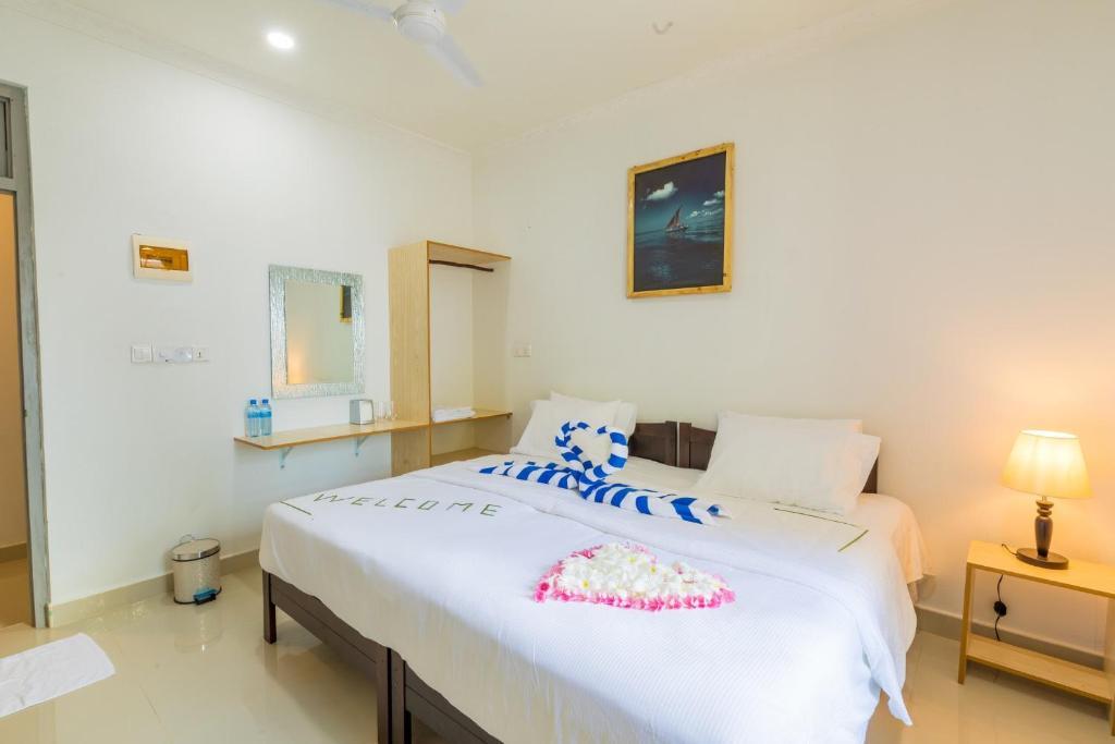 A bed or beds in a room at Kirulhiya Maldives