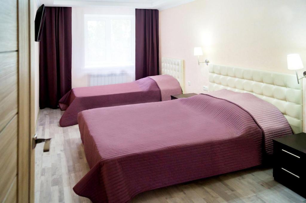 Кровать или кровати в номере 2 микрорайон дом 3 1