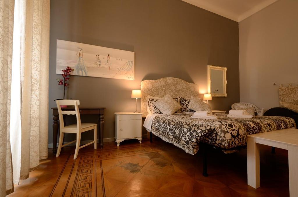 Letto o letti in una camera di Le Cupole di Trieste