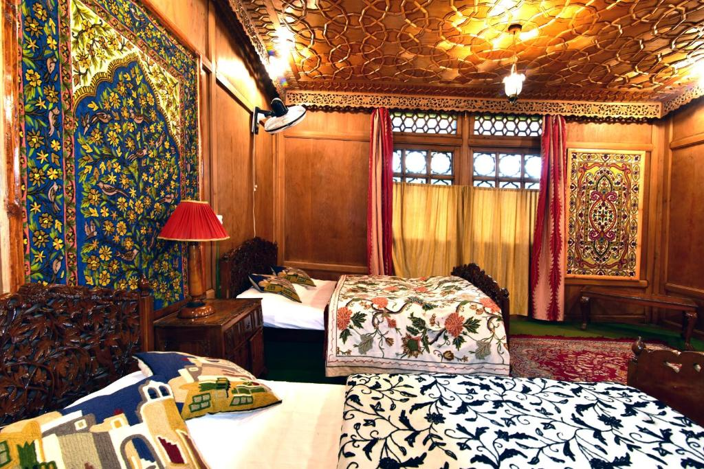 A bed or beds in a room at Houseboat Inshallah