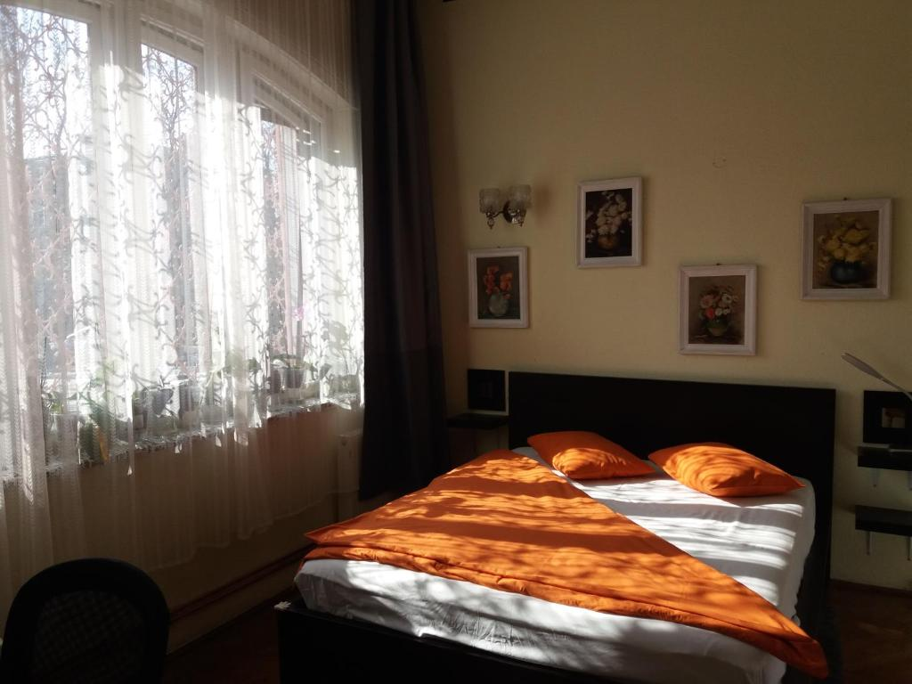 A bed or beds in a room at 12 Residence Cotroceni
