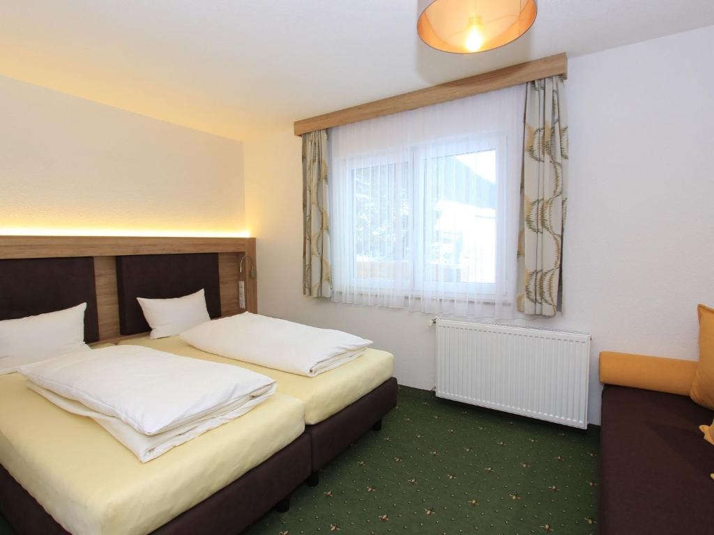 A bed or beds in a room at Ischgl Appartement 6
