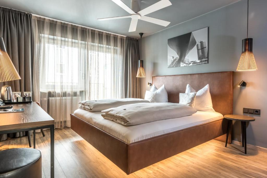 A bed or beds in a room at Bavaria Boutique Hotel