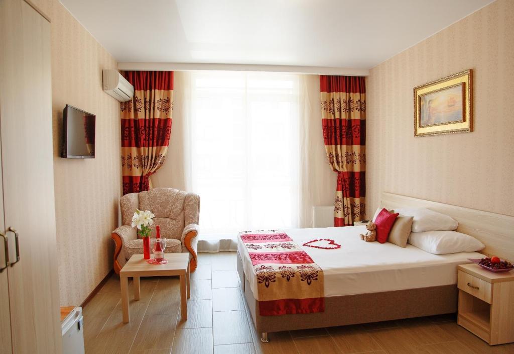 Кровать или кровати в номере Mini-hotel Divnomorskiy